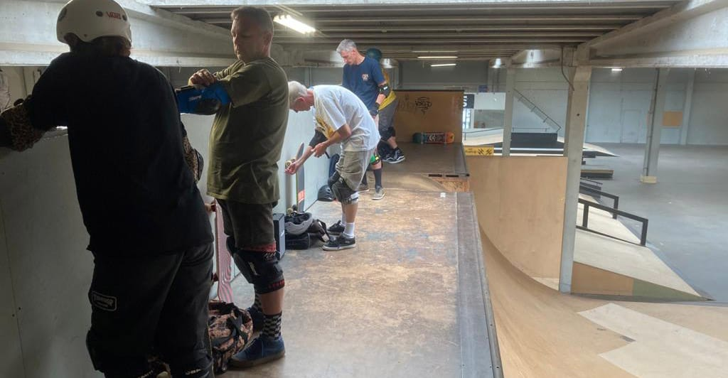 Old skateboarders in a skatepark