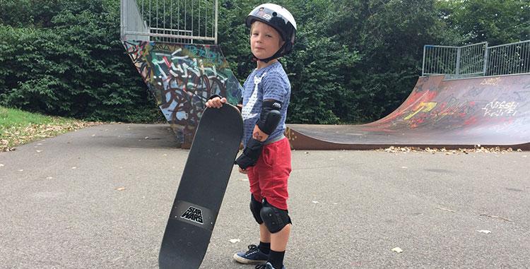 kid wearing protective skateboard gear