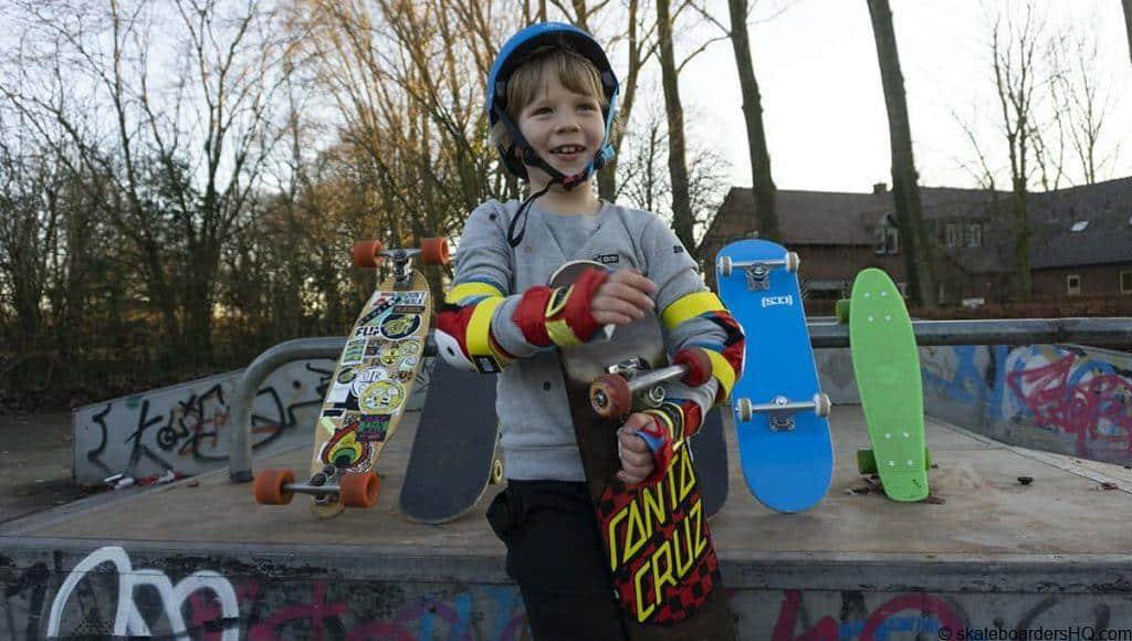 child holding a skateboard