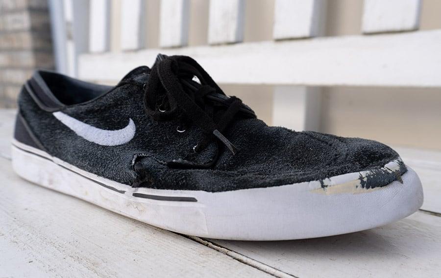 Skate shoe showing wear from skateboarding