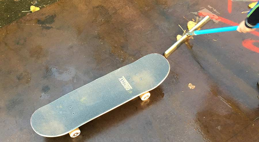 skateboard on a wet surface after rain