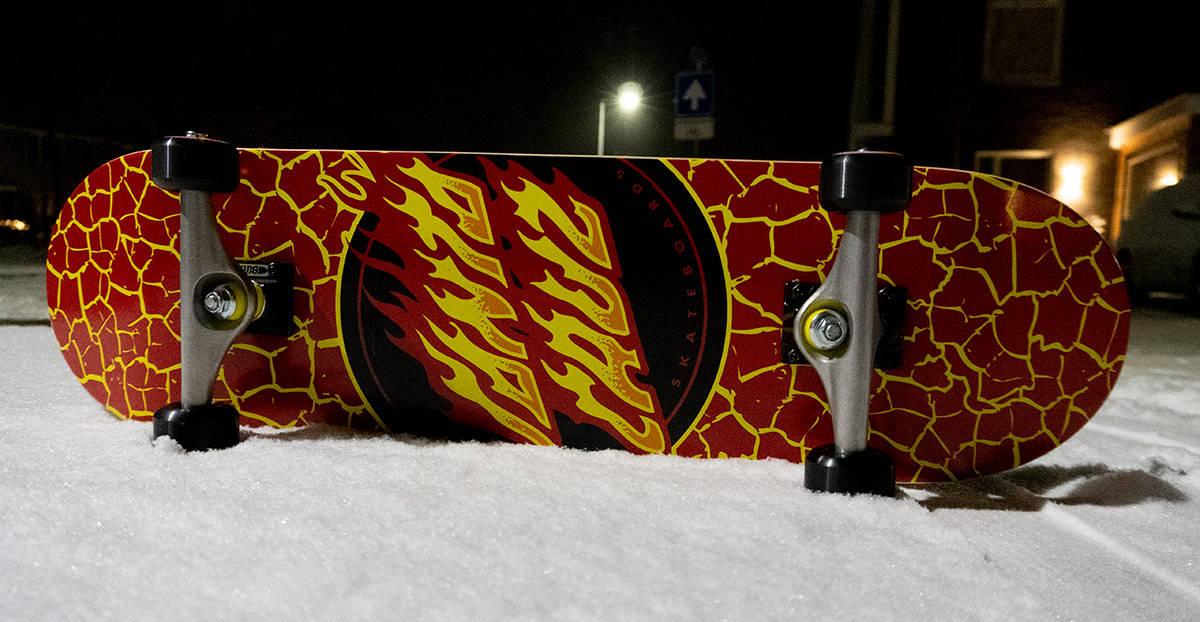 skateboard in the snow