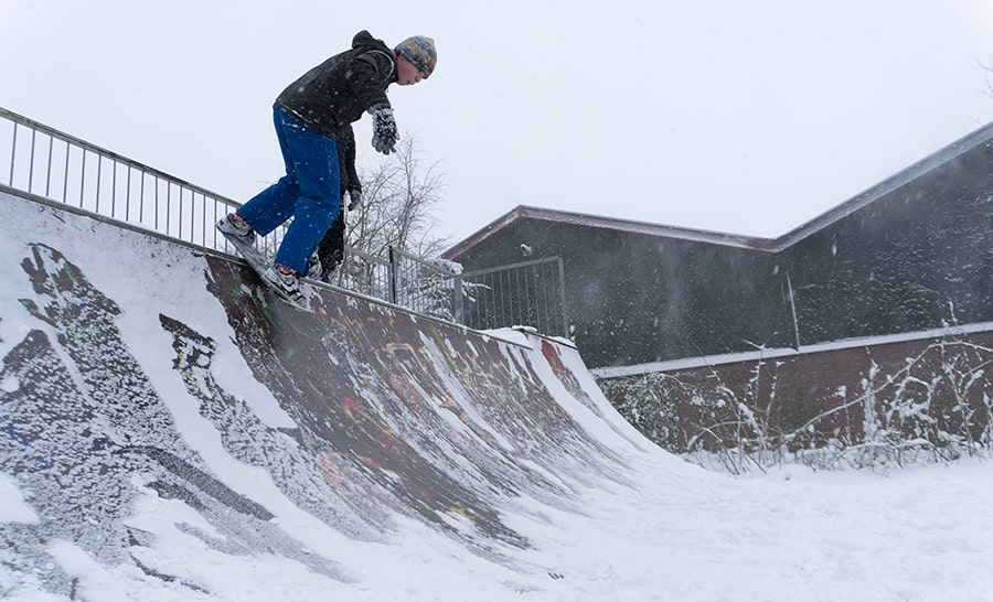 skateboarder in a mini ramp and snow