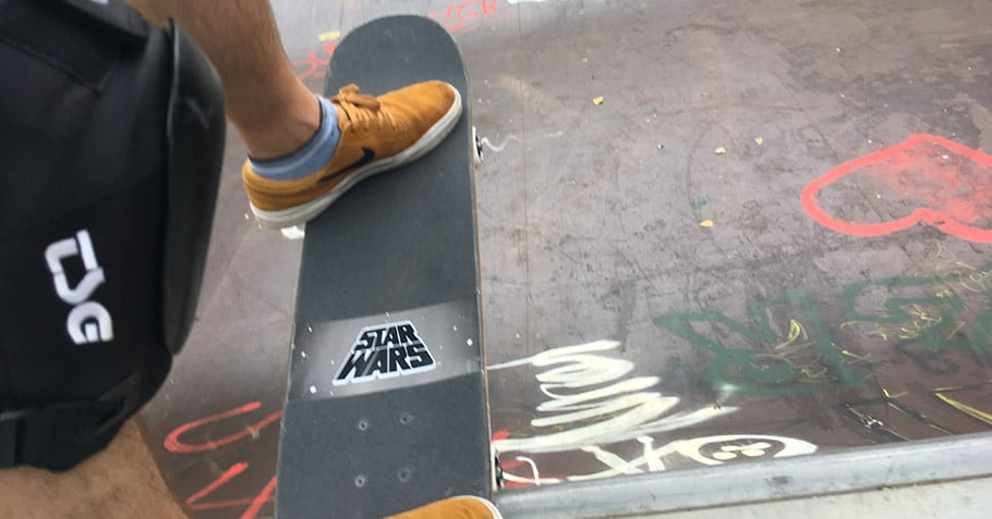 skateboarder doing a drop in