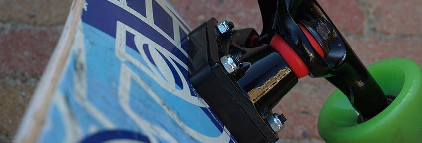 riser pads attached to skateboard trucks.jpgriser pads attached to skateboard trucks.jpgriser pads attached to skateboard trucks with longboard wheels