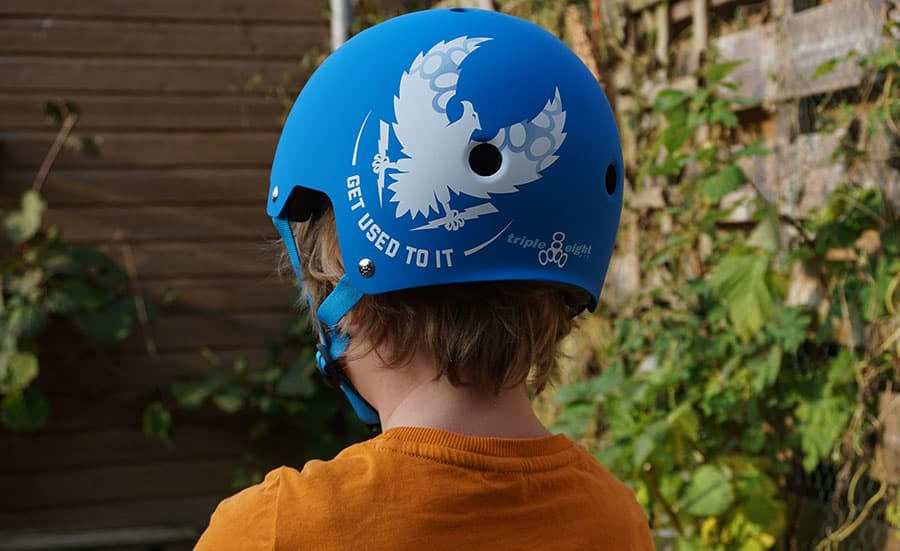 skateboard helmet on a kid from the back