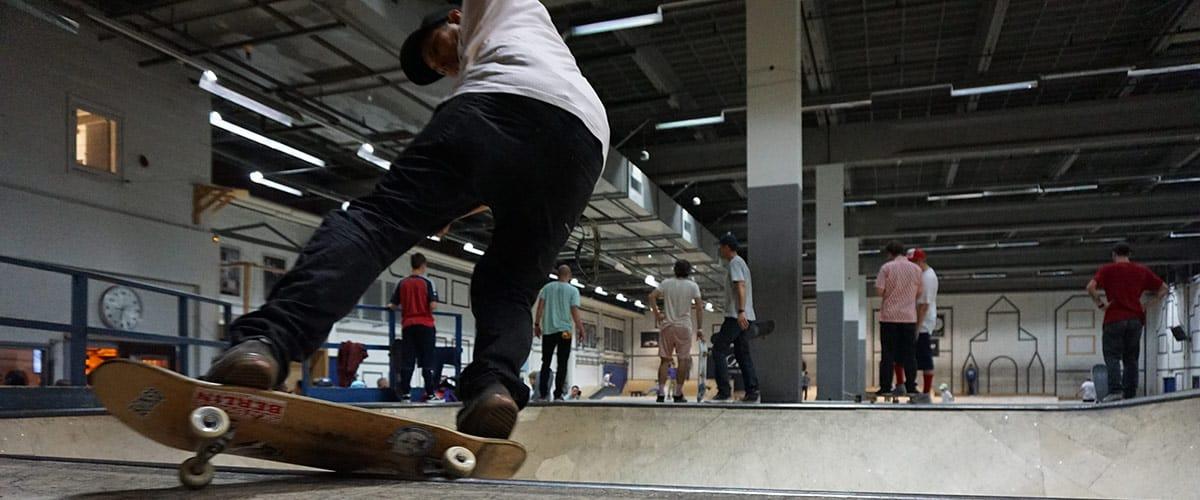 adult man on a skateboard in a skate park