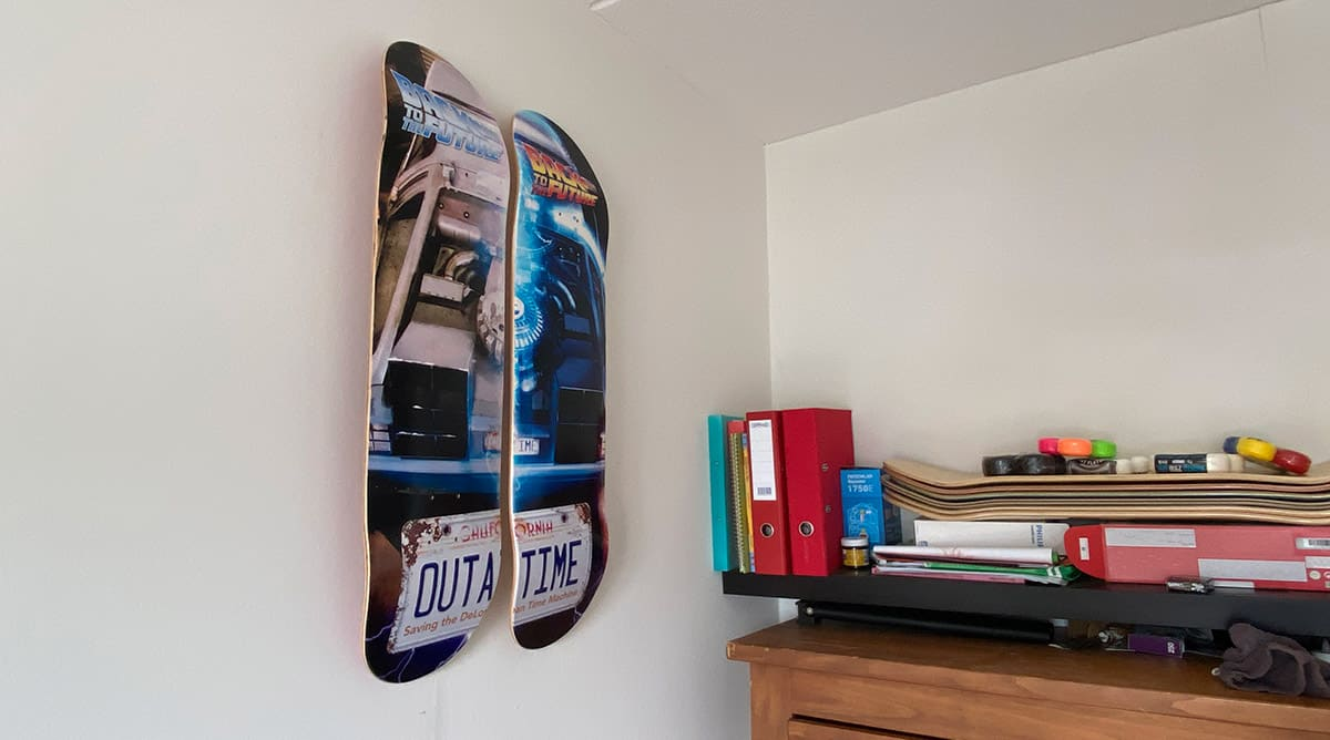 skateboard decks hanging on a wall