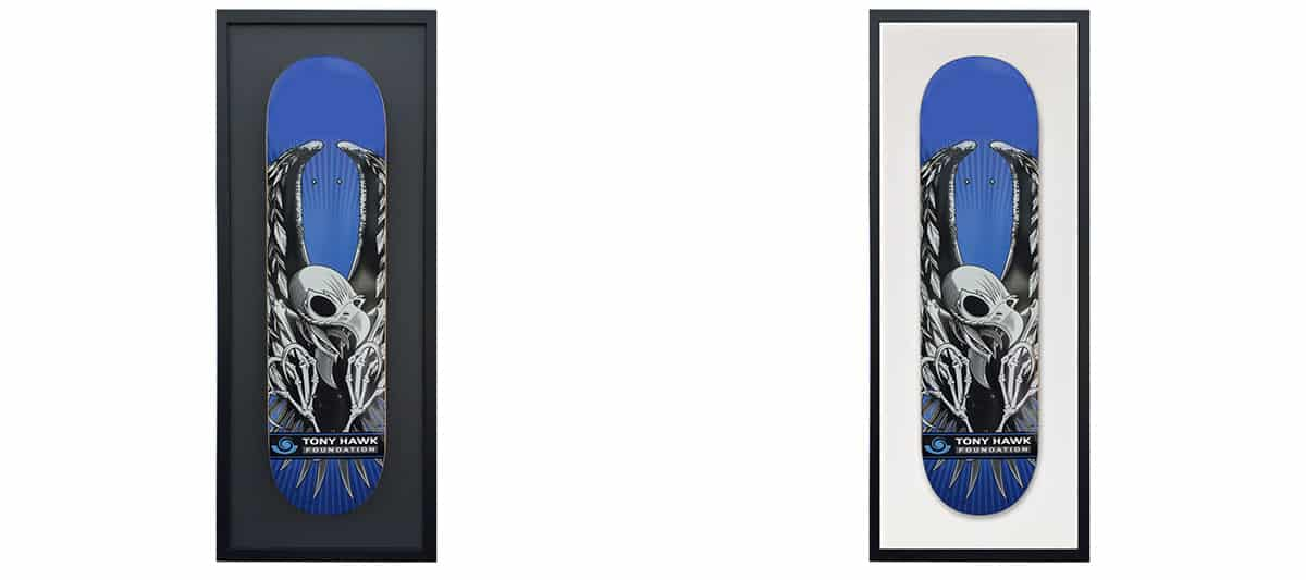 skateboard decks in a frame hanging on a wall