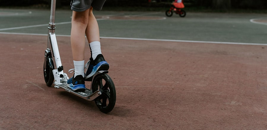 kick scooter on a tennis court