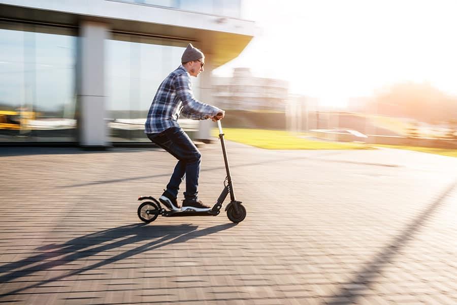 man riding fast on a kickscooter