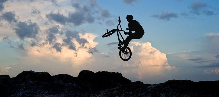 BMX dirt rider doing a trick