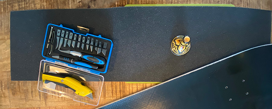Jessup grip tape, tools. and a skateboard deck