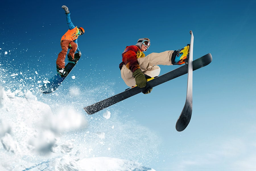 2 persons snowboarding and skiiing