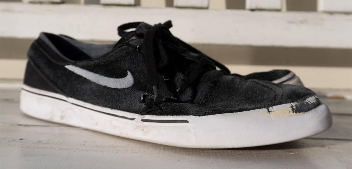 ripped nike skate shoe