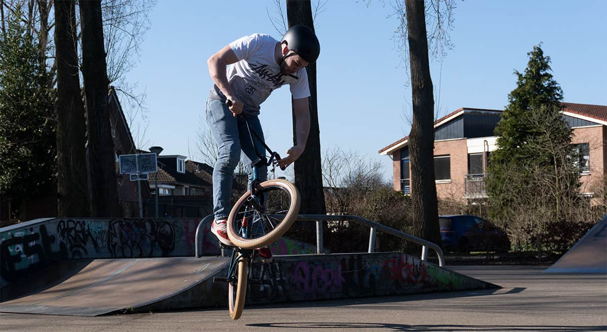 BMX rider performing a stunt in a skatepark