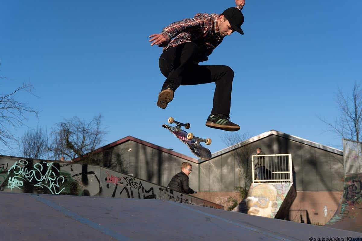 Skateboarder performing a kickflip