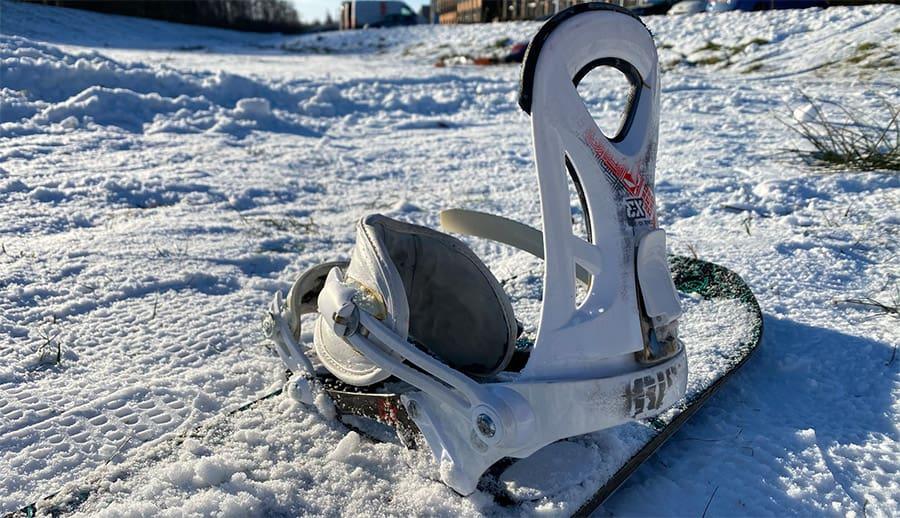 snowboard binding in the snow