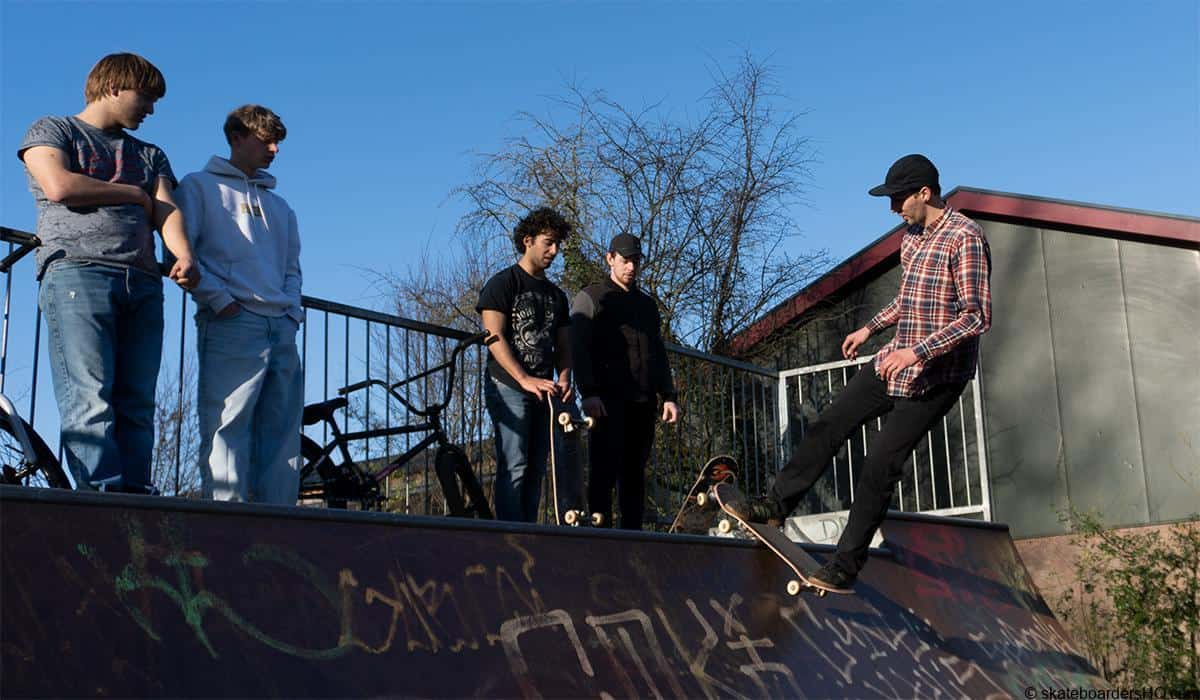 skateboarders in a skatepark having fun